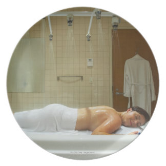 Woman enjoying hydrotherapy in vichy shower plate