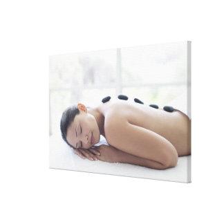 Woman enjoying lastone therapy canvas print