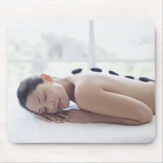 Woman enjoying lastone therapy mouse mat