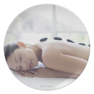 Woman enjoying lastone therapy plate