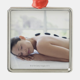 Woman enjoying lastone therapy Silver-Colored square decoration