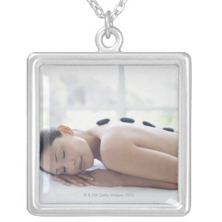 Woman enjoying lastone therapy silver plated necklace