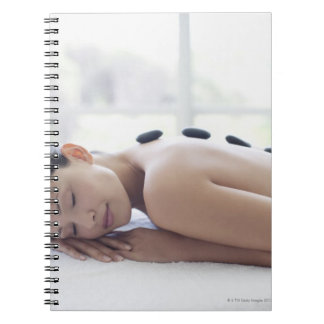 Woman enjoying lastone therapy spiral notebook