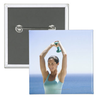 woman excercising with weights on her roof 15 cm square badge