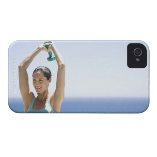 woman excercising with weights on her roof iPhone 4 case