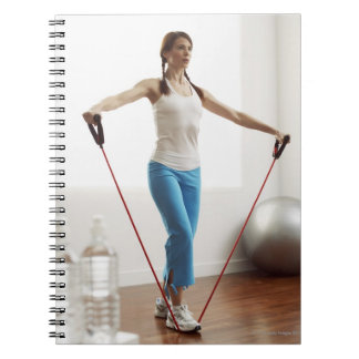 Woman Exercising Notebooks