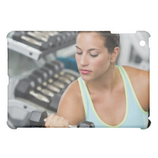 Woman exercising with dumbbells cover for the iPad mini