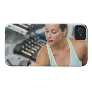 Woman exercising with dumbbells iPhone 4 covers