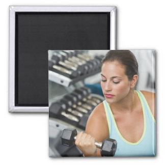 Woman exercising with dumbbells magnet