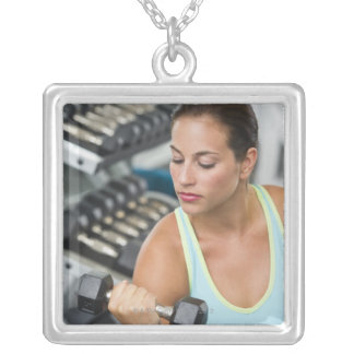 Woman exercising with dumbbells square pendant necklace