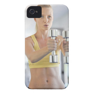 Woman exercising with weights iPhone 4 covers