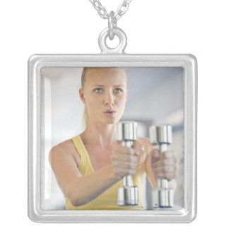 Woman exercising with weights silver plated necklace