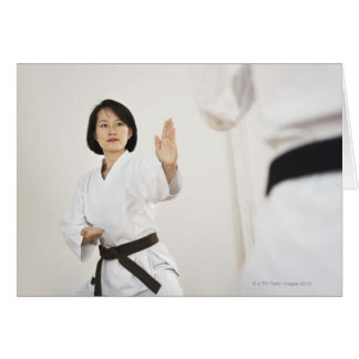 Woman fighting in karate competition card