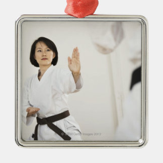 Woman fighting in karate competition Silver-Colored square decoration