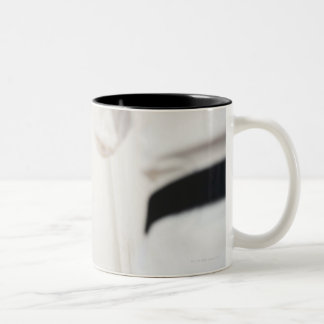 Woman fighting in karate competition Two-Tone coffee mug