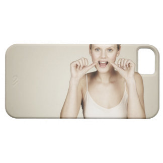 Woman flossing her teeth iPhone 5 cases