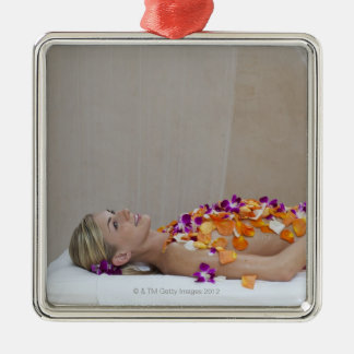 Woman getting a flower treatment at a spa. christmas ornament