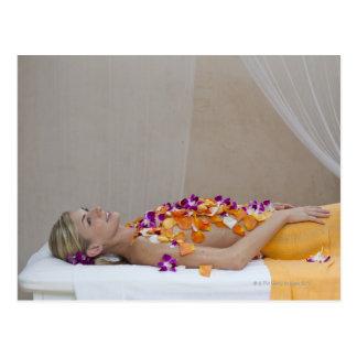 Woman getting a flower treatment at a spa. postcard
