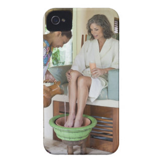 Woman getting a footbath at a spa in Mexico. iPhone 4 Covers