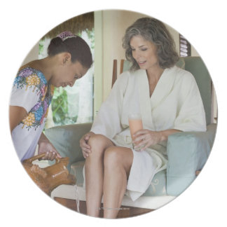 Woman getting a footbath at a spa in Mexico. Plate