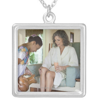 Woman getting a footbath at a spa in Mexico. Silver Plated Necklace