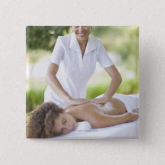 Woman getting a massage 15 cm square badge