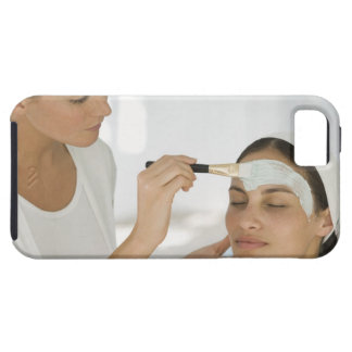 Woman getting beauty mud mask iPhone 5 covers