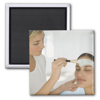 Woman getting beauty mud mask square magnet
