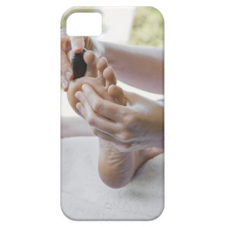 Woman getting foot massage with hot stone barely there iPhone 5 case