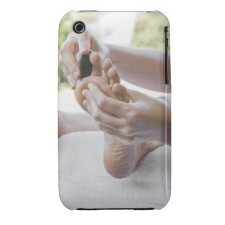 Woman getting foot massage with hot stone Case-Mate iPhone 3 cases