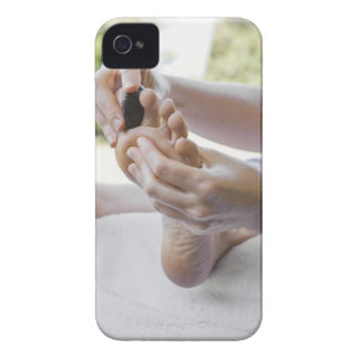 Woman getting foot massage with hot stone iPhone 4 Case-Mate case