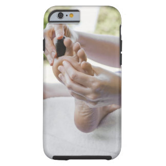 Woman getting foot massage with hot stone tough iPhone 6 case