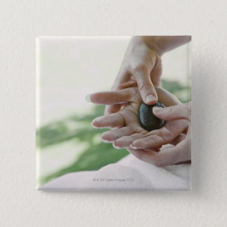Woman getting hand massage with hot stone 15 cm square badge