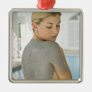 Woman getting spa skin treatment christmas ornament