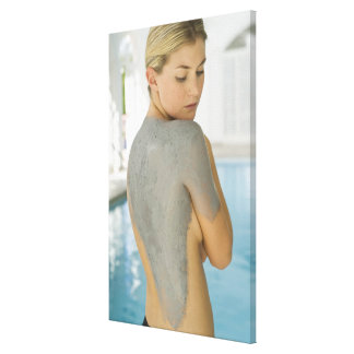 Woman getting spa skin treatment stretched canvas print