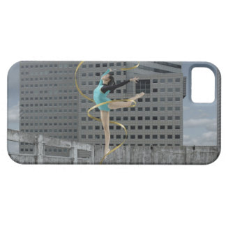 Woman gymnast outdoors on rooftop jumping in air iPhone 5 cover
