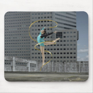 Woman gymnast outdoors on rooftop jumping in air mouse pad