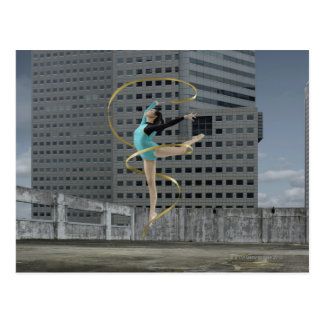 Woman gymnast outdoors on rooftop jumping in air postcard