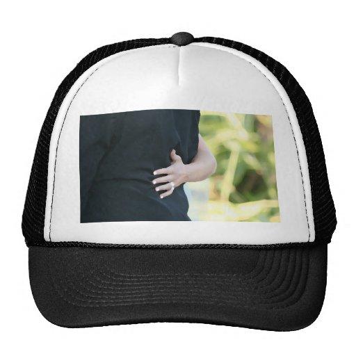 woman hand on black jacket man hat