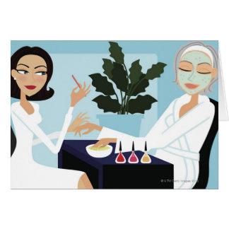 Woman having manicure and facial at spa greeting card