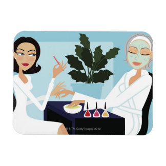 Woman having manicure and facial at spa rectangular photo magnet