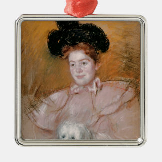 Woman holding a dog christmas ornament
