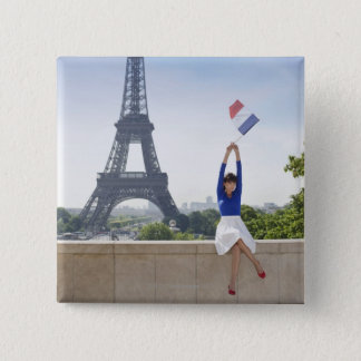 Woman holding a French flag sitting on a stone 15 Cm Square Badge