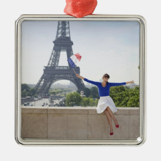 Woman holding a French flag sitting on a stone 2 Christmas Ornament