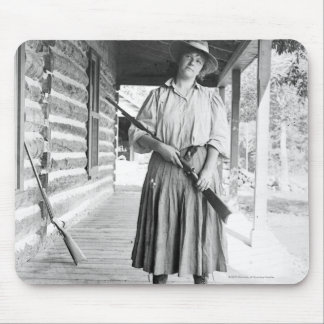 Woman holding a rifle on a porch mouse mat