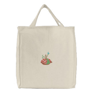 Woman holding butterfly embroidery canvas tote bag