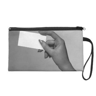 Woman Holding Card Wristlet Clutch