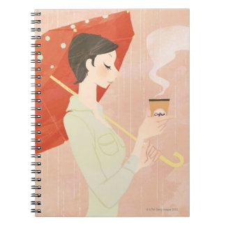 Woman Holding Coffee Notebooks