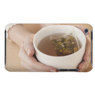 Woman holding cup with chamomile tea barely there iPod cover