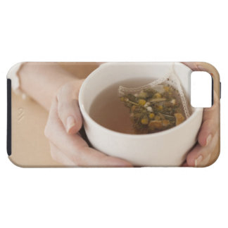 Woman holding cup with chamomile tea iPhone 5 cover